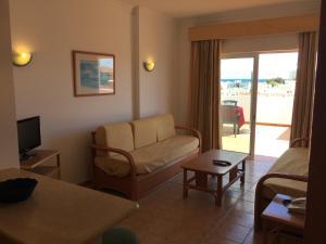 A seating area at Prestige For Home-APT Alagoa Praia Altura