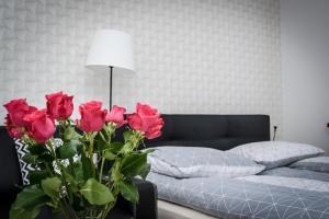 מיטה או מיטות בחדר ב-Apartamenty AP 1