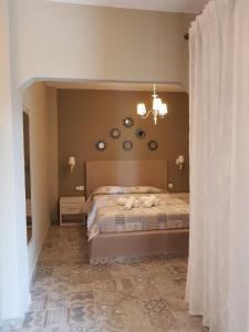 Llit o llits en una habitació de Agrili Apart Hotel