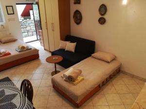 A bed or beds in a room at Studio Apartment Palma
