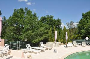 The swimming pool at or near Le Jas Du Colombier