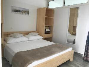 A bed or beds in a room at Apartmenthaus Suskovic Insel Krk
