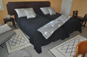 Säng eller sängar i ett rum på Lakeuden Lumo ja Tupa