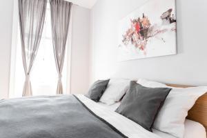 Ein Bett oder Betten in einem Zimmer der Unterkunft City Wohnung in perfekter Lage