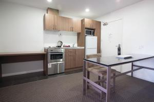 A kitchen or kitchenette at Waldorf St Martins Apartments Hotel