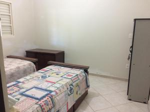 A bed or beds in a room at Casa Prox Camara Municipal