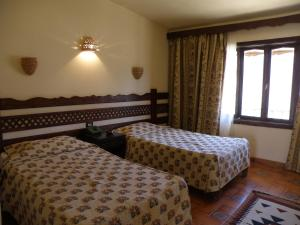 A bed or beds in a room at Daniela Village St.Katherine