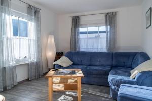 Ein Sitzbereich in der Unterkunft Ferienwohnungen Scheid Volker