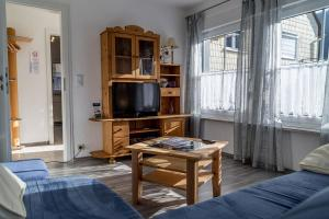 TV/Unterhaltungsangebot in der Unterkunft Ferienwohnungen Scheid Volker