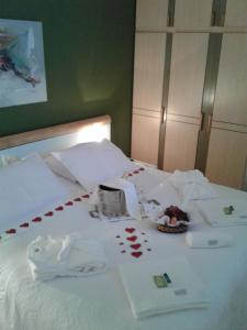 A bed or beds in a room at Apart Quartier Latin Hotel
