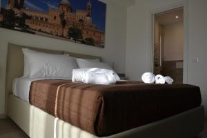 A bed or beds in a room at Il Moro