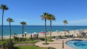 A view of the pool at Princesa Rocky Point by Castaways or nearby