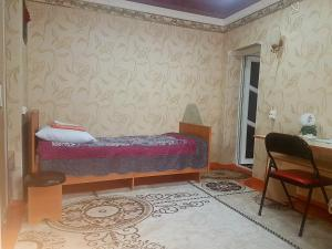 A bed or beds in a room at Guesthouse Kunduz