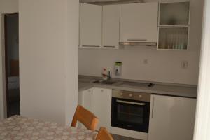 A kitchen or kitchenette at Seagarden Villa Resort