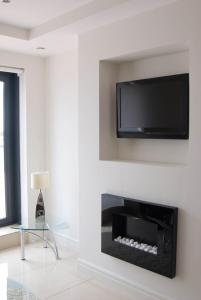 A television and/or entertainment center at The Western Citypoint Apartments
