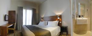 Ein Bett oder Betten in einem Zimmer der Unterkunft App-Arte Marseille Vieux-Port