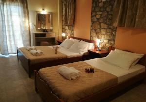 Un pat sau paturi într-o cameră la Alkionis