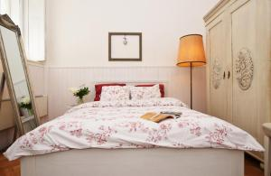 A bed or beds in a room at Romantic Apartment Prague
