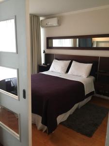 Cama o camas de una habitación en Providencia PRO Apart Hotel