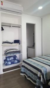 Łóżko lub łóżka w pokoju w obiekcie Unlimited Ocean Front