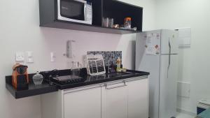 Kuhinja ili čajna kuhinja u objektu Unlimited Ocean Front