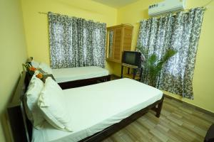 A bed or beds in a room at Namasthe Ayurveda Clinic and Ayurveda Nursing Home