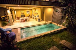 The swimming pool at or near Askara Villa Rice Field View
