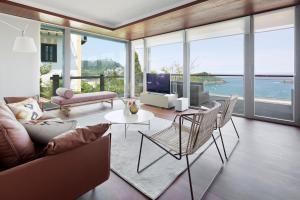 A seating area at Villa Baena by FeelFree Rentals