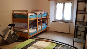"""A bunk bed or bunk beds in a room at """"Sous les Barres"""""""