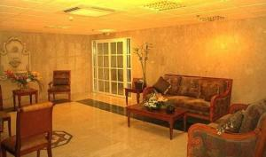A seating area at Al Sadd Suites Hotel