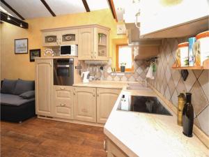 Kuhinja oz. manjša kuhinja v nastanitvi One-Bedroom Apartment in Marezige