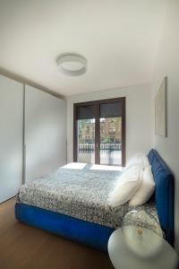 A bed or beds in a room at Viale Severino Boezio 20