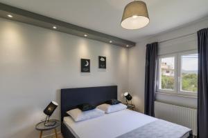 Postel nebo postele na pokoji v ubytování Villa Apartment AA 2