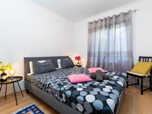 A bed or beds in a room at Apartmani Maria