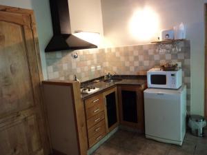 Una cocina o kitchenette en Las Golondrinas - UF 319