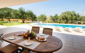The swimming pool at or near Corfu Erimitis