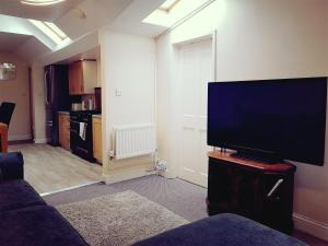 A television and/or entertainment center at Otters' Holt