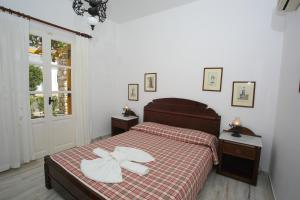 A bed or beds in a room at Ostria
