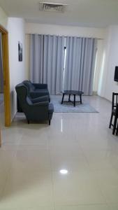 A seating area at Al Wadi Rental Homes - Mashael Building