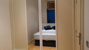 Ein Bett oder Betten in einem Zimmer der Unterkunft La Latina