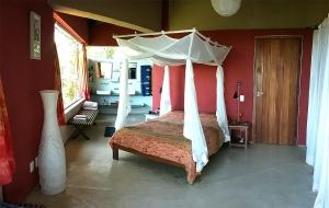 A bed or beds in a room at Recanto Beija-Flor