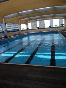The swimming pool at or near Al Wadi Rental Homes - Mashael Building