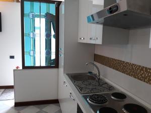 A kitchen or kitchenette at mini loft galeazze