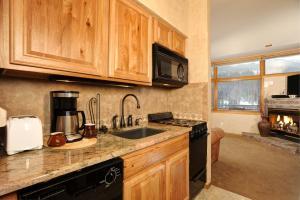 A kitchen or kitchenette at River Run Village by Keystone Resort