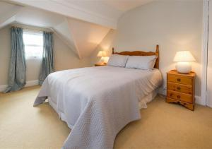 A bed or beds in a room at Wendon