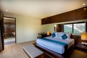 A bed or beds in a room at Asa Bali Luxury Villas & Spa