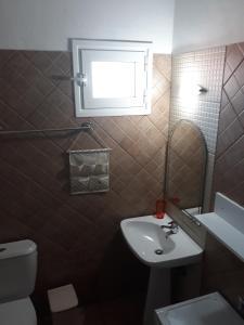 Koupelna v ubytování Filoxenia Apartments
