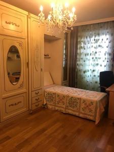 Кровать или кровати в номере apartamenty-kvartira