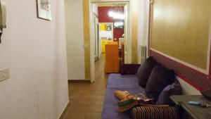 A seating area at Appartamento Corso dei Tintori by DdV Tourist Apartments