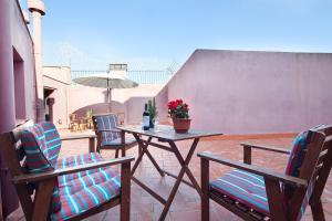 Un balcón o terraza de Enjoybarcelona Apartments